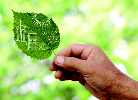 Leaf with illustration of sustainable energy drawn on it being held in a male right hand