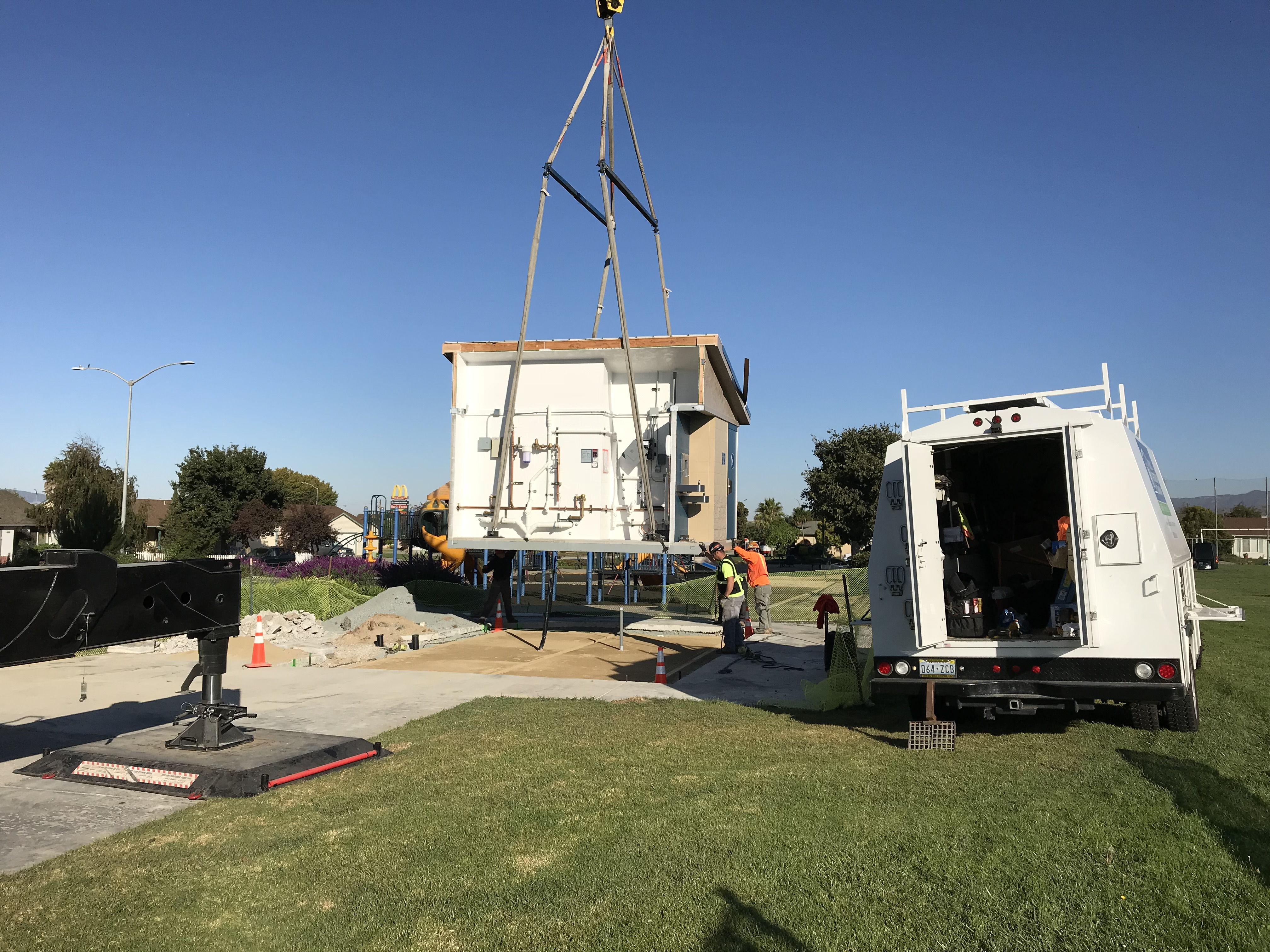 crews work to install new prefabricated restroom facility