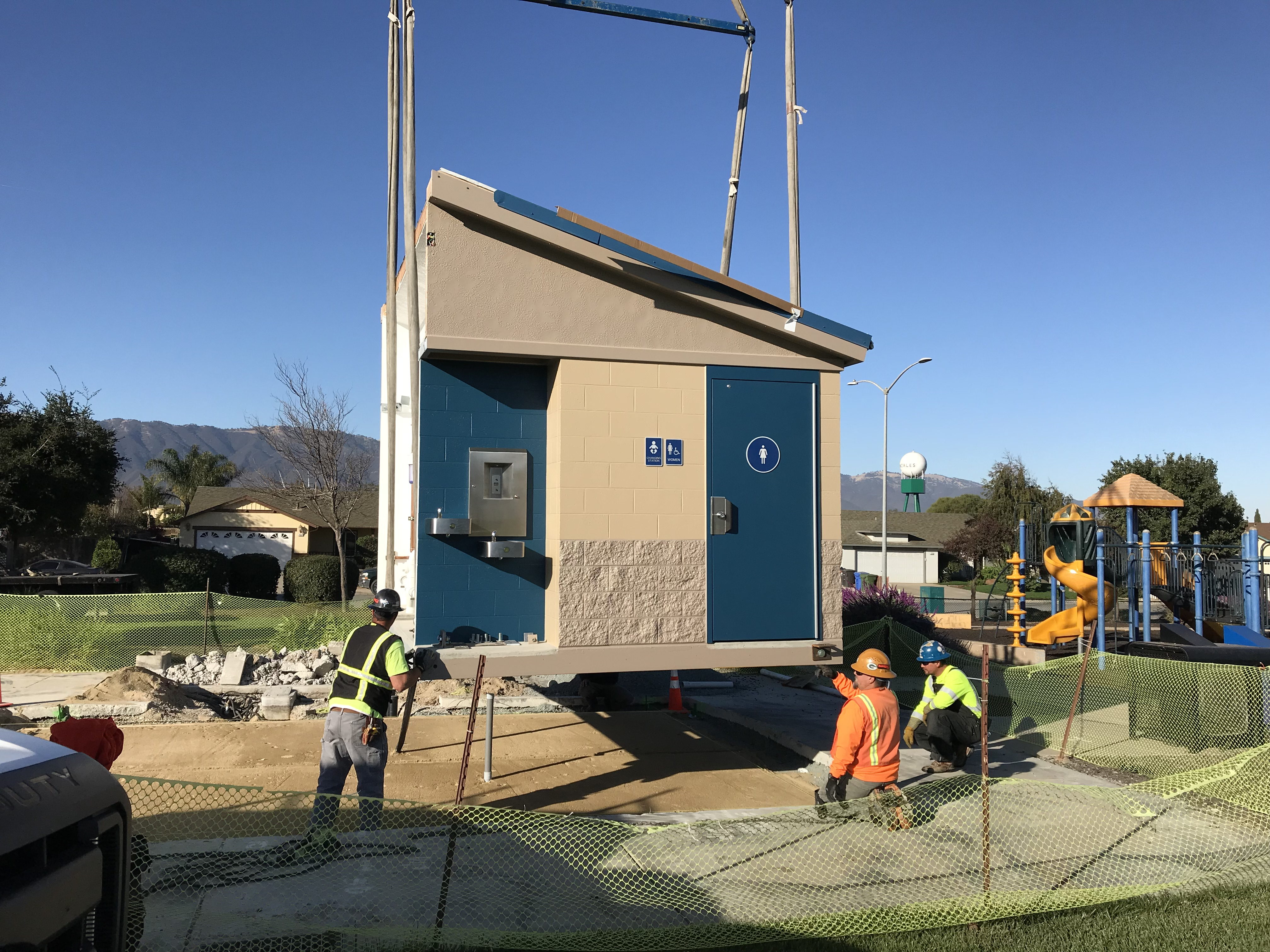 workers installing the two piece prefab unit