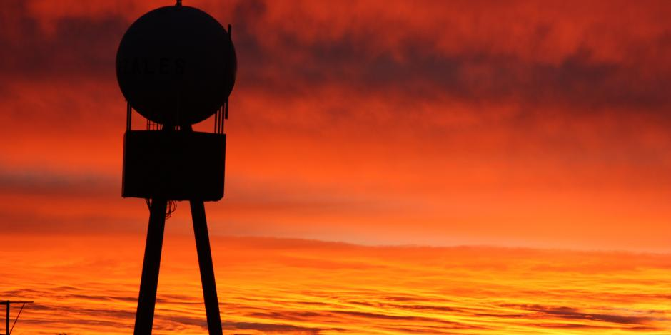 Silhouette of Gonzales Water Tower with sunset sky