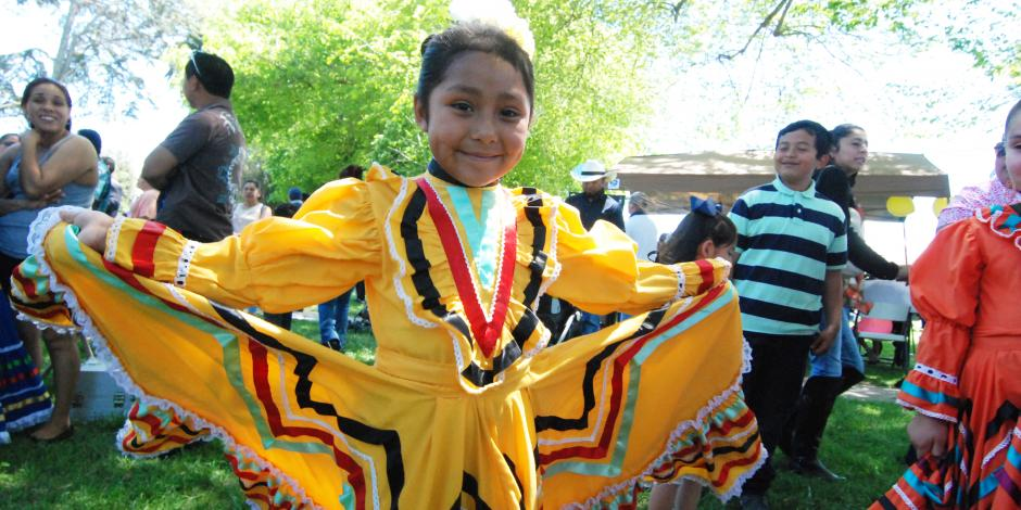 Young girl in yellow traditional Mexican dress