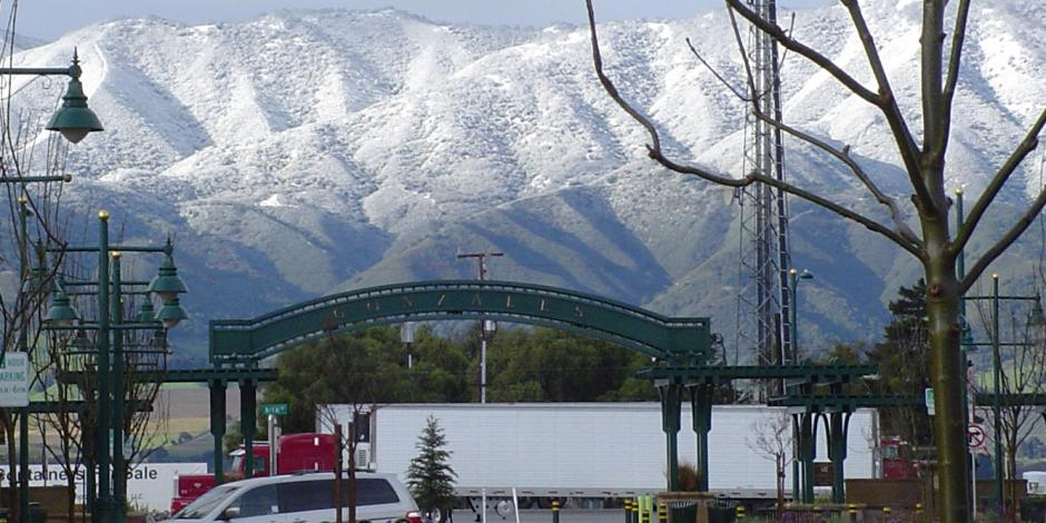 Gonzales Arch with Snowy Mountains
