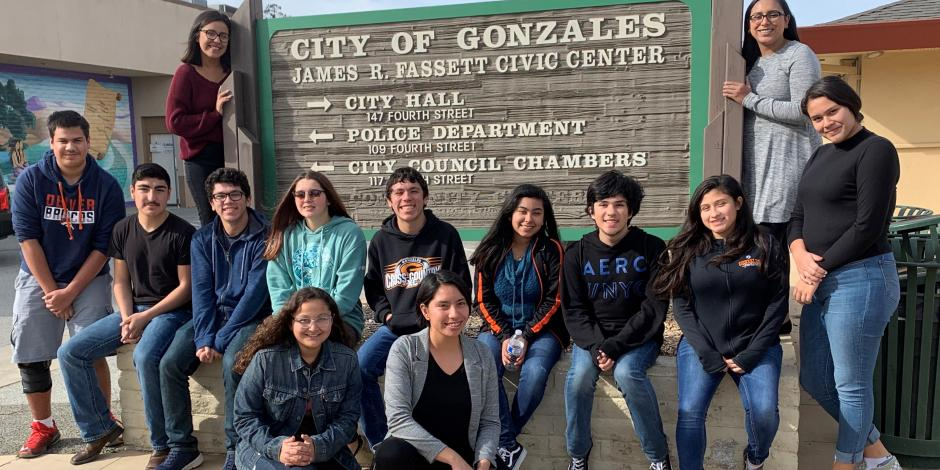 Gonzales Youth Council in front of the Gonzales City Hall Sign