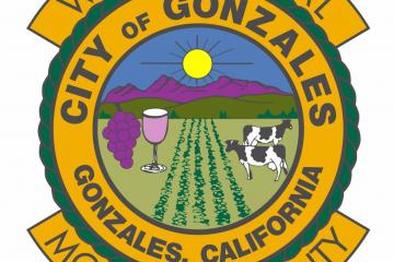 City of Gonzales city seal, graphic of mountains, wine, cow, and field