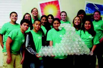 Youth with wave made out of recycled plastic bottles
