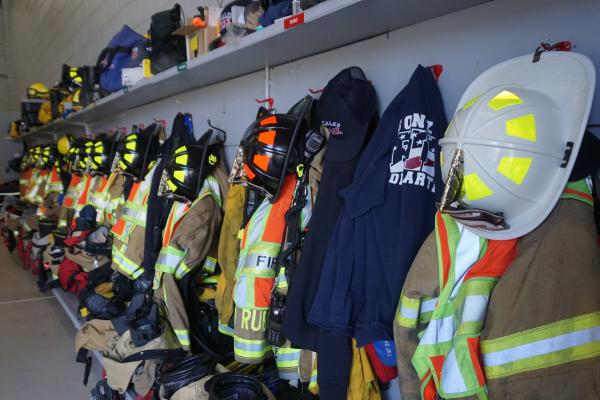Photo of Fire Department helmets and jackets